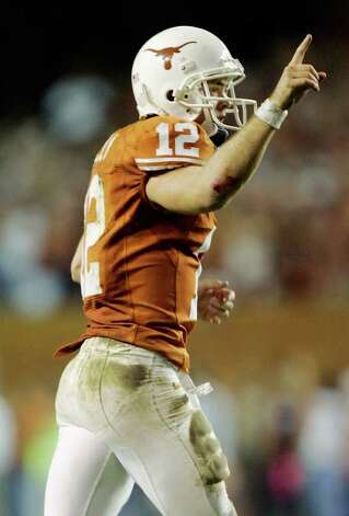 AUSTIN, TX - NOVEMBER 27:  Quarterback Colt McCoy #12 of the Texas Longhorns celebrates a touchdown to teammate wide receiver Quan Cosby #6 against the Texas A&M Aggies in the final minute of the second quarter at Darrell K Royal-Texas Memorial Stadium November 27, 2008 in Austin, Texas.  (Photo by Brian Bahr/Getty Images) *** Local Caption *** Colt McCoy Photo: Brian Bahr, Getty Images / 2008 Getty Images