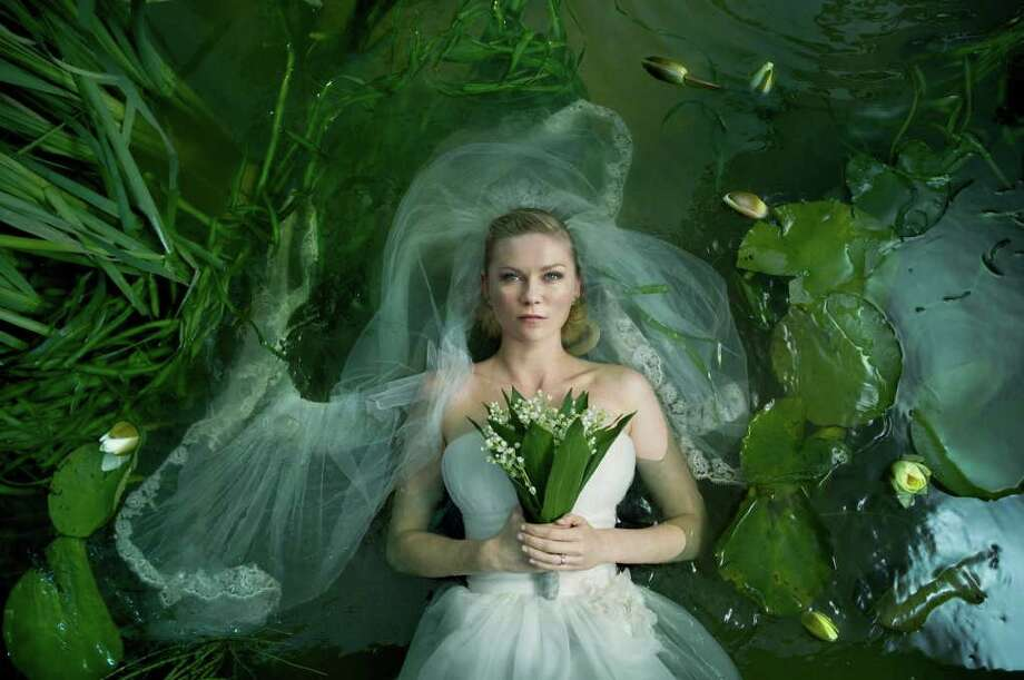 MAGNOLIA PICTURES GOOD CONCEPT: Kirsten Dunst stars as a woman suffering from a depression she can mask but not shake in Lars von Trier's Melancholia. Photo: Magnolia Pictures