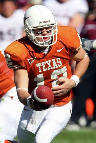 FOR SPORTS - Longhorns' Colt McCoy looks to hand off against the Aggies Friday Nov. 24, 2006 at Texas Memorial Stadium in Austin, Texas. The Aggies went on to win 12-7. PHOTO BY EDWARD A. ORNELAS/STAFF Photo: EDWARD A. ORNELAS, SAN ANTONIO EXPRESS-NEWS / SAN ANTONIO EXPRESS-NEWS