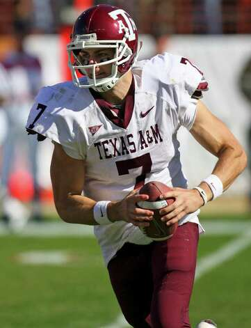 FOR SPORTS - Aggies' Stephen McGee looks for running room against the Longhorns Friday Nov. 24, 2006 at Texas Memorial Stadium in Austin, Texas. The Aggies went on to win 12-7. PHOTO BY EDWARD A. ORNELAS/STAFF Photo: EDWARD A. ORNELAS, SAN ANTONIO EXPRESS-NEWS / SAN ANTONIO EXPRESS-NEWS