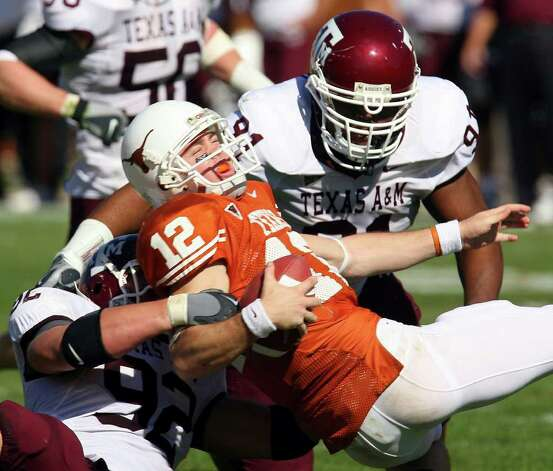 FOR SPORTS - Longhorns' Colt McCoy is sacked by Aggies' Chris Harrington and Kellen Heard Friday Nov. 24, 2006 at Texas Memorial Stadium in Austin, Texas. The Aggies went on to win 12-7. PHOTO BY EDWARD A. ORNELAS/STAFF Photo: EDWARD A. ORNELAS, SAN ANTONIO EXPRESS-NEWS / SAN ANTONIO EXPRESS-NEWS