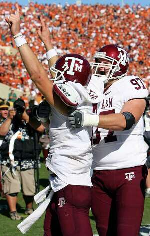 FOR SPORTS - Aggies' Stephen McGee celebrates with teammate Alex Kotzur after scoring the winning touchdown to defeat the Longhorns 12-7 Friday Nov. 24, 2006 at Texas Memorial Stadium in Austin, Texas. PHOTO BY EDWARD A. ORNELAS/STAFF Photo: EDWARD A. ORNELAS, SAN ANTONIO EXPRESS-NEWS / SAN ANTONIO EXPRESS-NEWS
