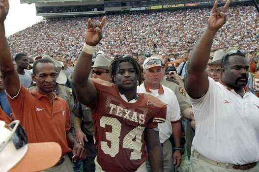 27 Nov 1998: Running back Ricky Williams #34 of the Texas Longhorns celebrates during the game against the Texas A&M Aggies at the Memorial Stadium in Austin, Texas. The Longhorns defeated the Aggies 26-24. Photo: Brian Bahr, Getty Images / Getty Images North America