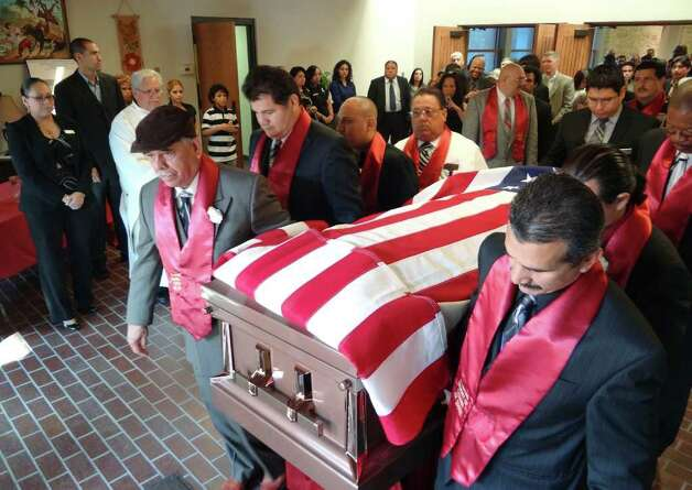 Boxing cutman Joe Souza's casket is carried from the Resurrection of the Lord Catholic Church after his funeral Mass on Tuesday. Photo: BILLY CALZADA, SAN ANTONIO EXPRESS-NEWS / gcalzada@express-news.net