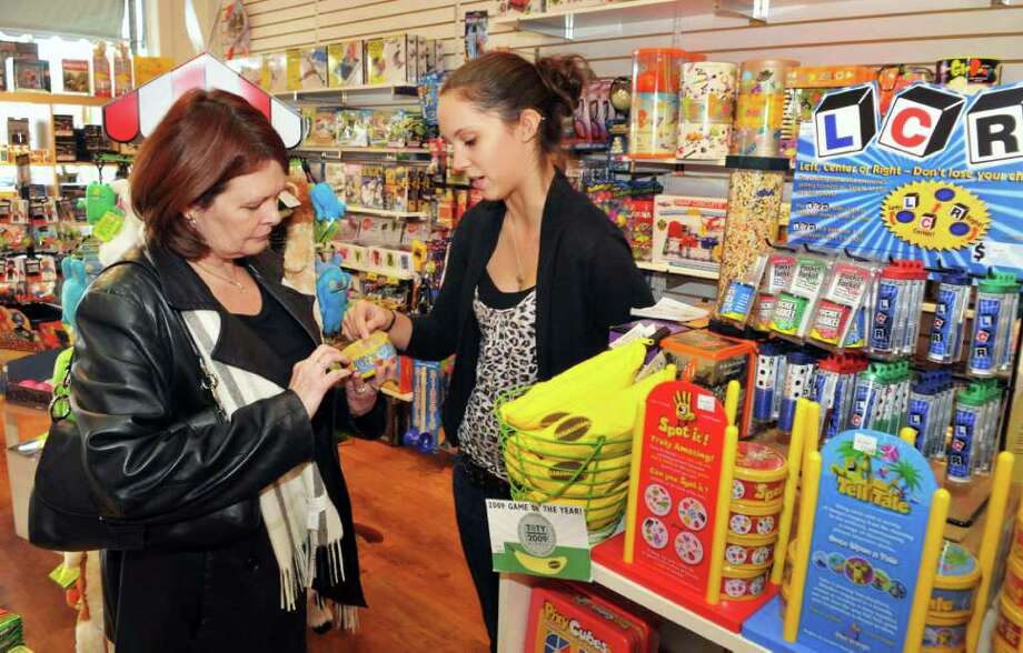 Kathy Lenic, left, of Guilderland gets some gift ideas from staore associate Autumn Kuklinski in Ta-da's at Stuyvesant Plaza in Albany Tuesday Nov. 22, 2011.   (John Carl D'Annibale / Times Union) Photo: John Carl D'Annibale / 00015512A