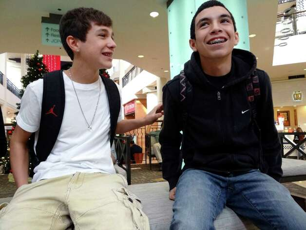Austin Mahone, left, and his longtime friend, Robert Villanueva, share a laugh at North Star Mall on Saturday, Nov. 19, 2011. Photo: BILLY CALZADA, SAN ANTONIO EXPRESS-NEWS / gcalzada@express-news.net