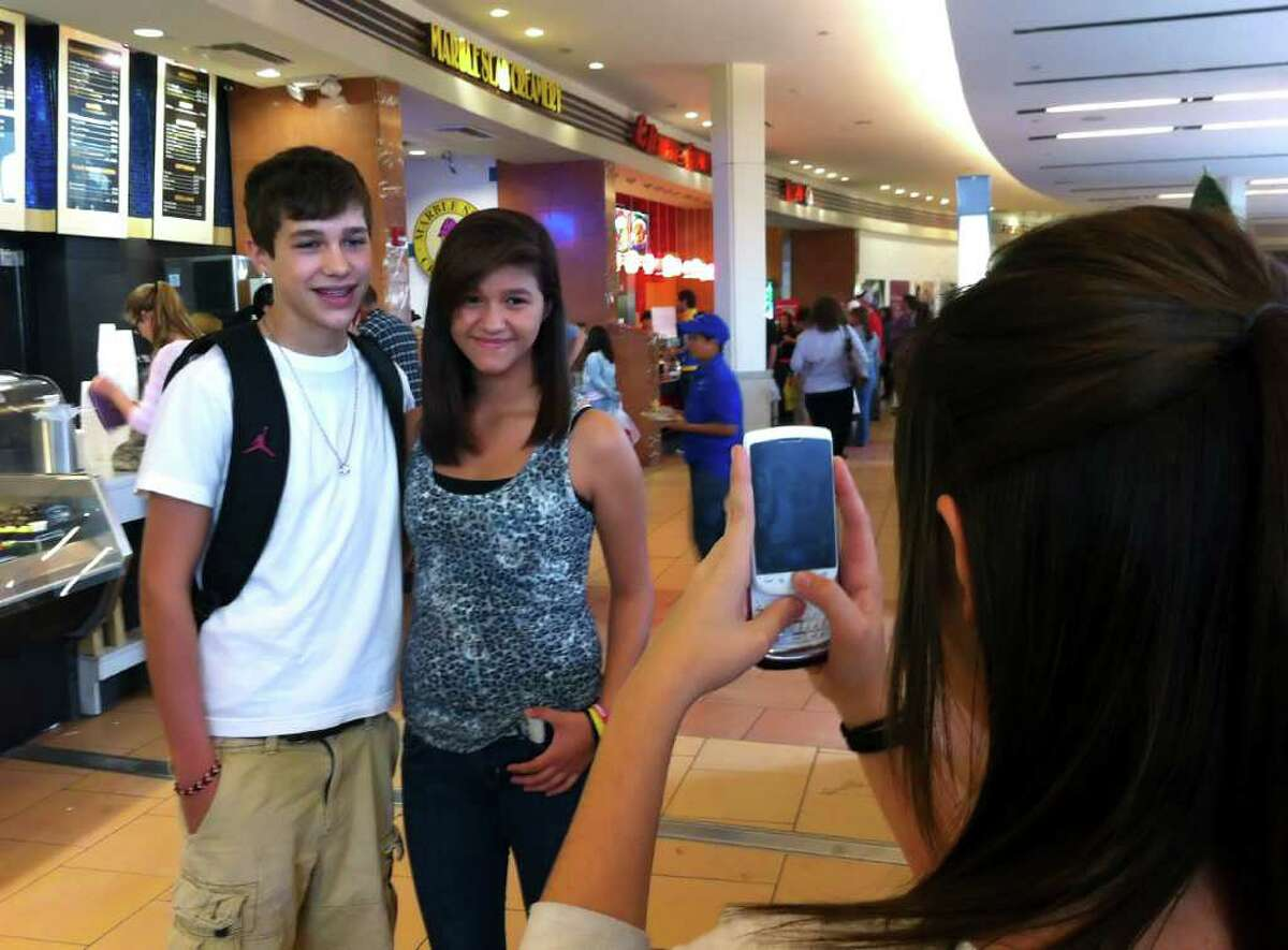 BILLY CALZADA : SAN ANTONIO EXPRESS-NEWS STAR POWER?: Austin Mahone, 15, who dreams of being a big star, poses with Dominique Villarreal, as her friend, Taylor Barrios, snaps a picture, in a San Antonio mall on Saturday.