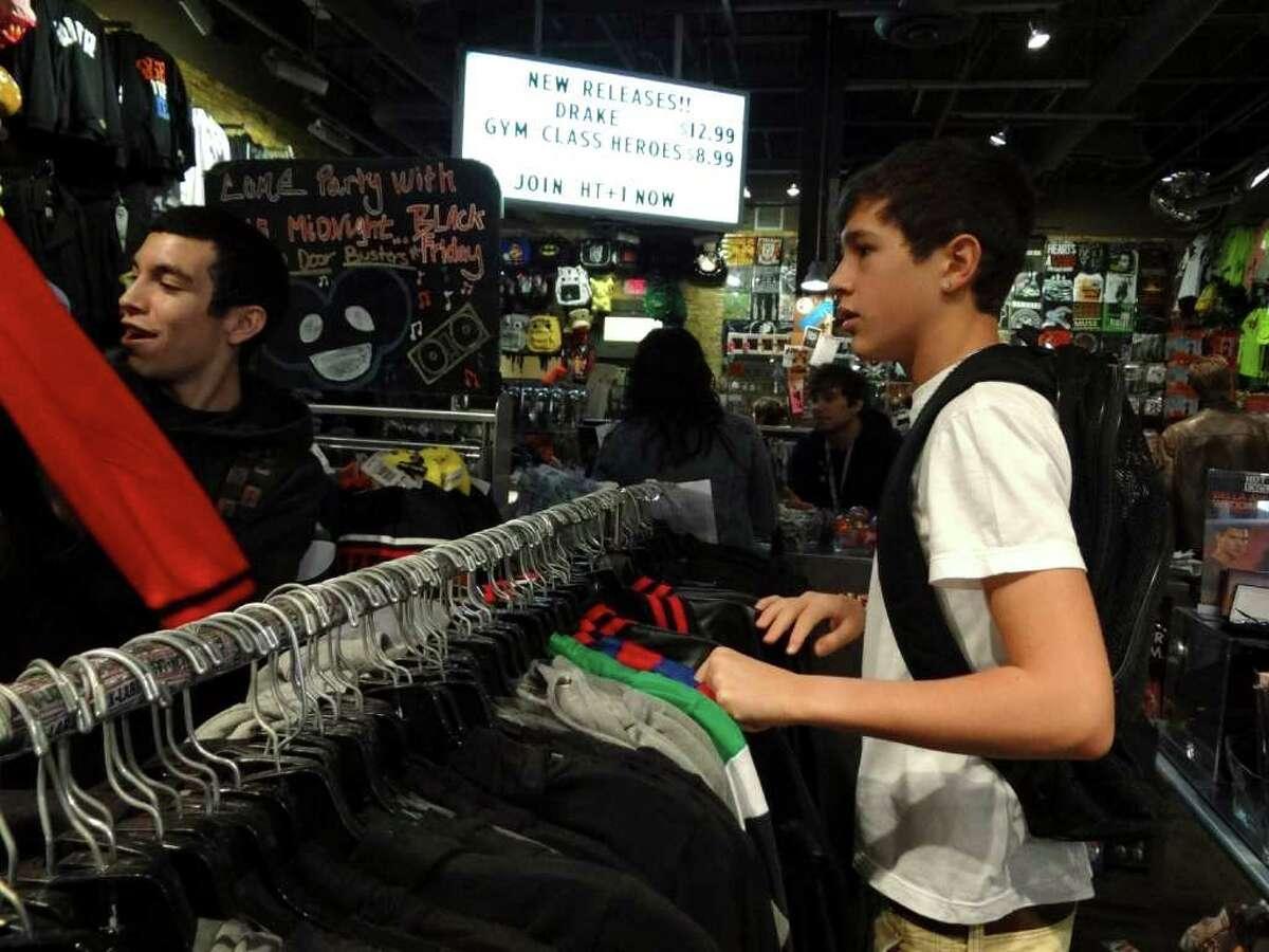 Austin Mahone, 15, an aspiring singer, and his friend, Robert Villanueva, shop at Northpark Mall on Saturday, Nov. 19, 2011. They have been friends since fifth grade. BILLY CALZADA / gcalzada@express-news.net