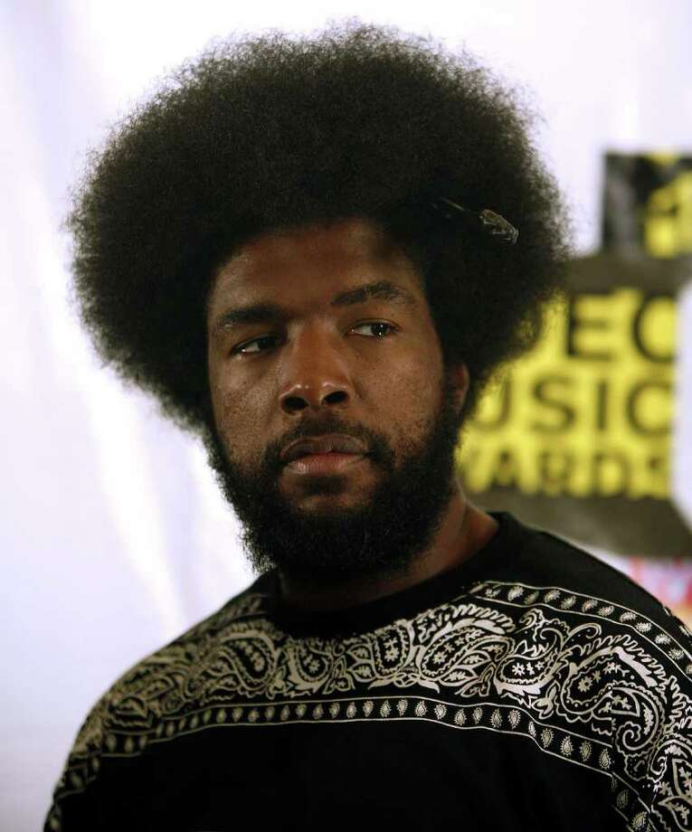 "Hip hop artist Ahmir ""?uestlove"" Thompson, of The Roots, poses during the MTV Video Music Awards Forum at Radio City Music Hall Wednesday, Aug. 30, 2006 in New York.  The 2006 MTV Video Music Awards, hosted by Jack Black, will be held Thursday, Aug. 31, at New York's Radio City Music Hall.  (AP Photo/Jason DeCrow) Photo: JASON DECROW / AP"