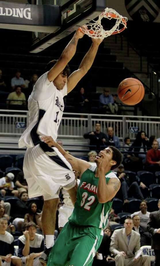 Rice forward Arsalan Kazemi (14) dunks over Florida A&M forward Vaughn Rose (32) during the second half of an NCAA college basketball game at Tudor Field House Tuesday, Nov. 22, 2011, in Houston. Rice beat Florida A&M 75-59. Photo: Brett Coomer, Houston Chronicle / © 2011 Houston Chronicle