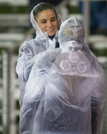 Rain gear was in fashion among the Oxford cheerleaders during the SWC football game against Pomperaug Tuesday night, Nov. 22, 20011, at Pomperaug High School in Southbury. Photo: Barry Horn / The News-Times Freelance