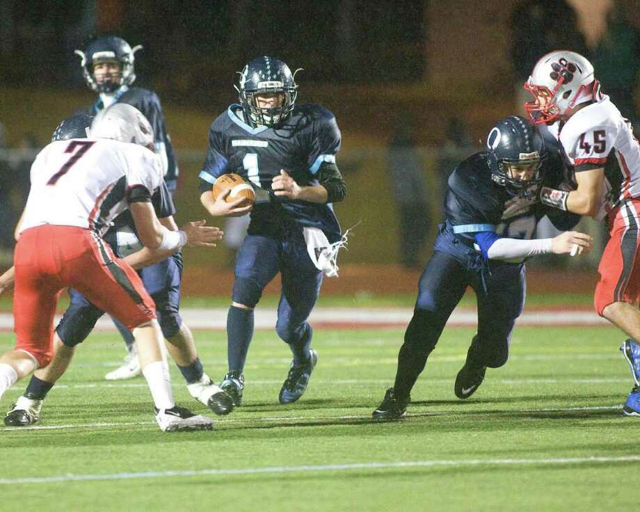 Oxford's Chris Hovan (1) uses a block from Steven Persson on Pomperaug's Mike Calo to pickup yardage during their SWC football game Tuesday night, Nov. 22, 2011, at Pomperaug High School in Southbury. Photo: Barry Horn / The News-Times Freelance