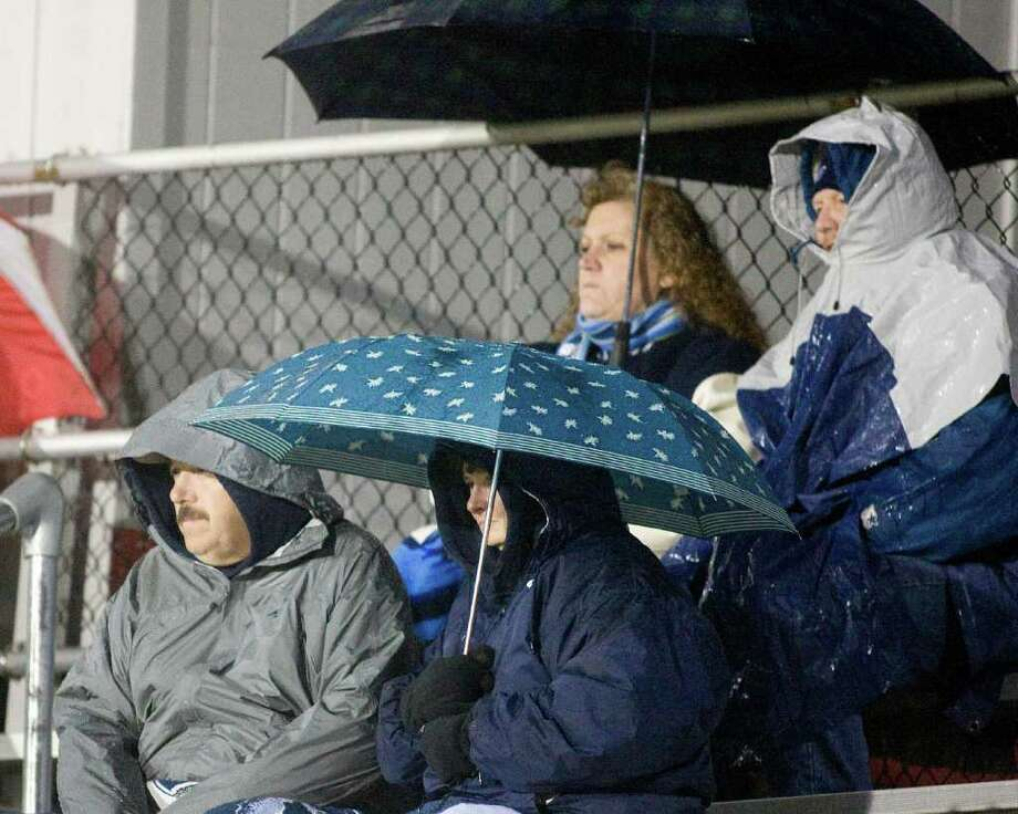 Umbrellas were an important accessory during Oxford's SWC football game against Pomperaug Tuesday night, Nov. 22, 2011, at Pomperaug High School in Southbury. Photo: Barry Horn