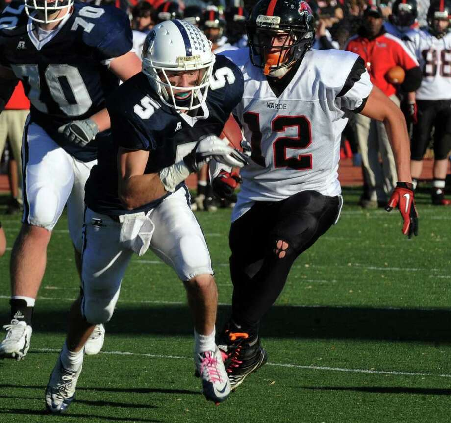 Staples' Nick Kelly, 5, finds an opening against Fairfield Warde Nov. 5. Kelly is one the Wreckers' top runners, pass-catchers and punt returners and his performance Thanksgiving morning will play a major role for Staples in its quest to beat Greenwich for the FCIAC title. Photo: Christian Abraham / Staff Photographer