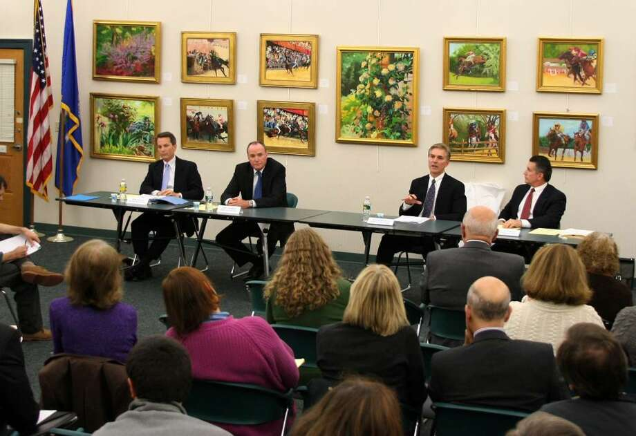 GOP incumbent First Selectman Thomas Herrmann, second from right, answers a question during a debate at the Easton Public Library in Easton, Conn. on Wednesday Oct. 21, 2009. From left to right is democratic challengers Bob Lessler for Second Selectman, challenger Chris Neubert for First Selectman, Easton's First Selectman Tom Herrmann, and Second Selectman Scott Centrella. Photo: Christian Abraham / Connecticut Post