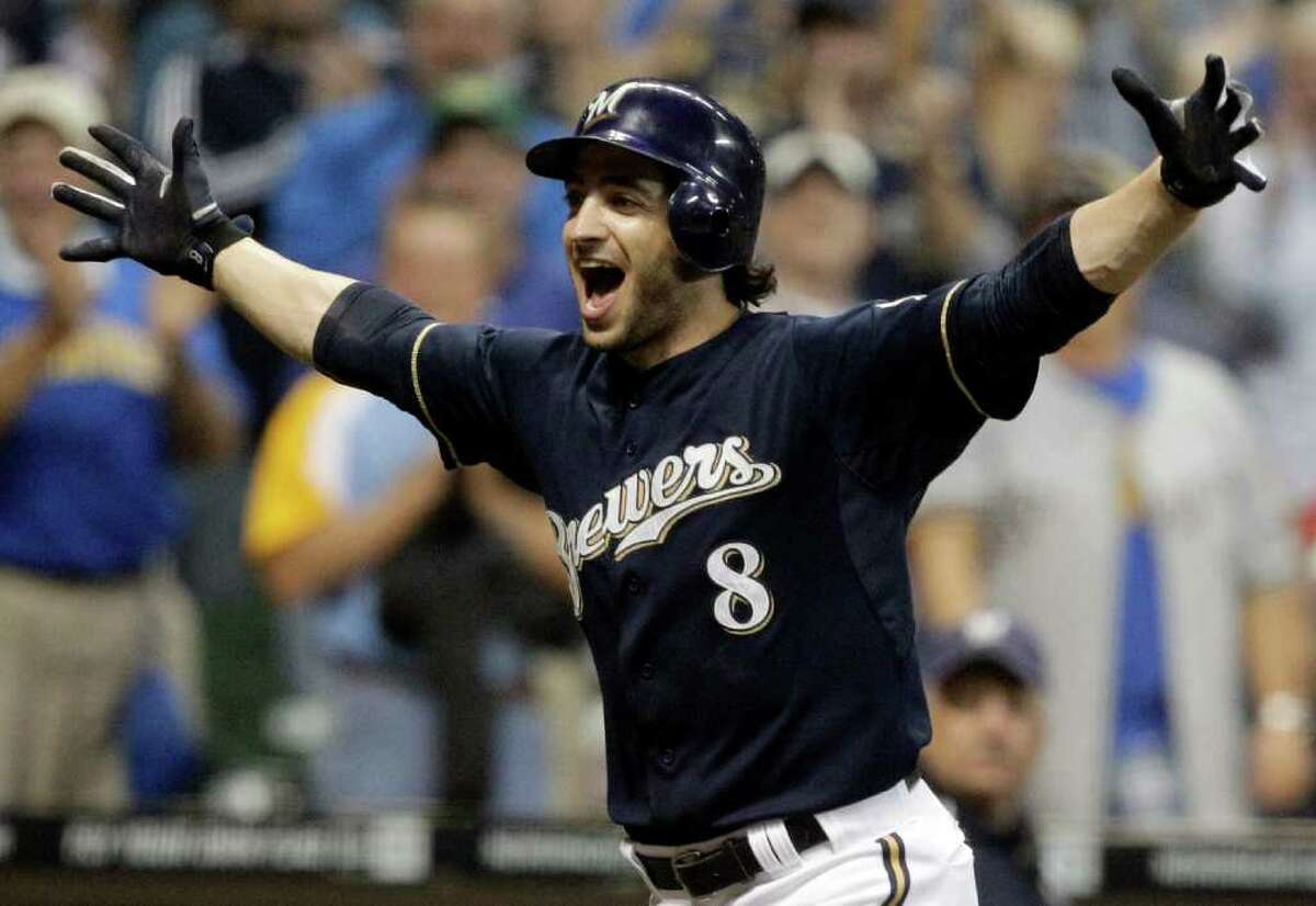 In this Sept. 13, 2011 file photo, Milwaukee Brewers' Ryan Braun reacts after hitting a game-winning home run during the 11th inning of a baseball game against the Colorado Rockies, in Milwaukee. Braun won the National League MVP Award that year.