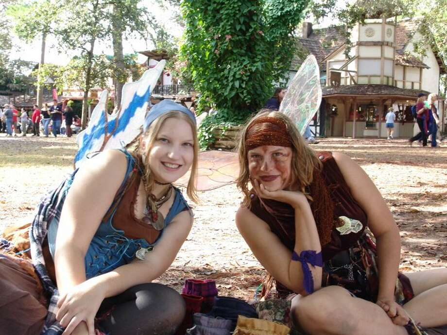 Lindsay Patterson, left, and her sister, Britt, performed as sand art fairies during the Texas Renaissances Festival in 2004.  Photo: Bryan Kirk