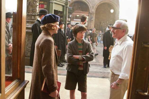 "Scorsese, right, chats with actors Chloë Grace Moretz (left) and Asa Butterfield during a break on the set of ""Hugo."" Photo: Jaap Buitendijk / © 2011 GK Films.  All Rights Reserved."