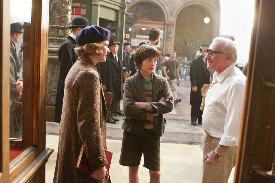 GK FILMS SCHOOL IS IN SESSION: Martin Scorsese, right, Chloë Grace Moretz and Asa Butterfield discuss a scene during a break on the set of Hugo. Photo: Jaap Buitendijk / © 2011 GK Films.  All Rights Reserved.