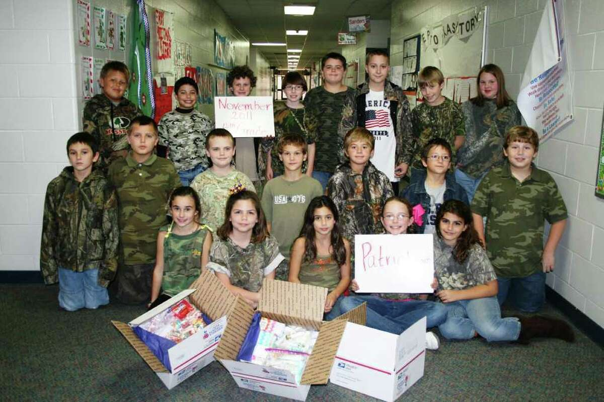 Students from Lumberton Intermediate helped collect items for care packages to be sent to soldiers for Christmas. Pictured; back row, from left, Reagan Watkins, Anthony Gutierrez, Lucas Leach, Cade Smith, Dylan Stock, Koltin Brown, Hayden Tucker, Payin Wead; middle row, from left, Kaleb Turner, Orion Reed, Jakob Wood, Nick Stock, Kade Barnard, Spencer Howard, David Haley, front row, from left, Charolotte Chambers, Errolyn Borland, Jordan Guerrero, Kendyl Wilke, Brooklyn Broussard.