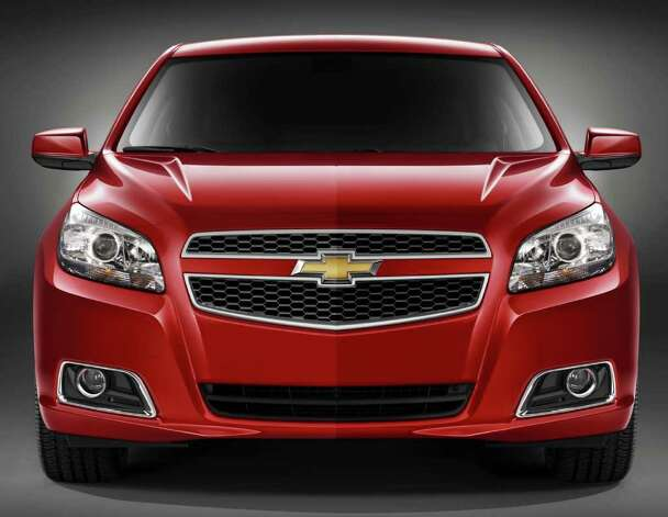 "The redesigned 2013 Chevrolet Malibu gets an all-new front-end appearance with what GM calls a ""wide, aggressive stance."" COURTESY OF GENERAL MOTORS CO. Photo: General Motors Co., COURTESY OF GENERAL MOTORS CO. / Chevrolet"