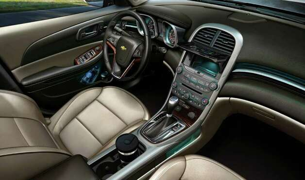 The cockpit of the 2013 Chevrolet Malibu Eco model includes bucket seats, a center console with cup holders and storage, and a variety of standard amenities. COURTESY OF GENERAL MOTORS CO. Photo: General Motors Co., COURTESY OF GENERAL MOTORS CO. / Chevrolet