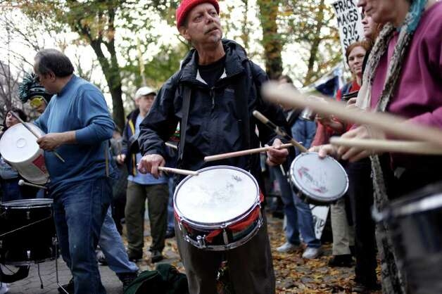 Occupy Wall Street protesters play drums down the block from New York City mayor Michael Bloomberg's house in New York, Sunday, Nov. 20, 2011. Occupy Wall Street protesters planned to drum in front of the mayor's house for 24 hours, but police closed the street to all pedestrian traffic. Photo: AP