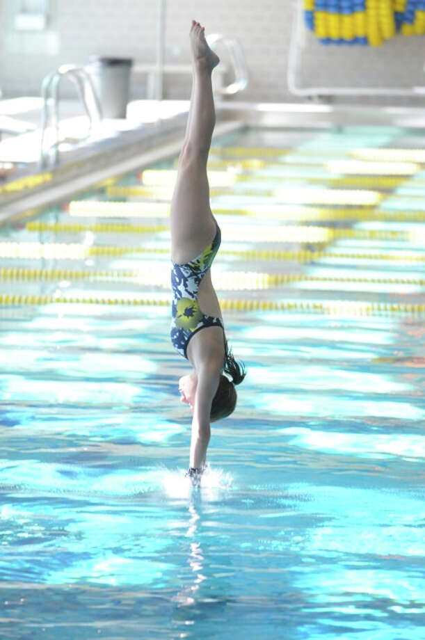 Warde's Kylie More, pictured above at a diving meet in Pittsburgh, finished 14th at the State Open this year. Photo: Contributed Photo