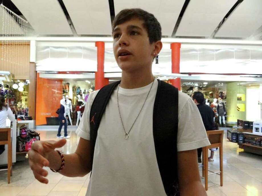 Austin Mahone, walks through North Star Mall on Saturday, Nov. 19, 2011. Mahone, 15, has been gaining popularity as a young singer via the internet. Photo: BILLY CALZADA, BILLY CALZADA / Gcalzada@express-news.net / gcalzada@express-news.net
