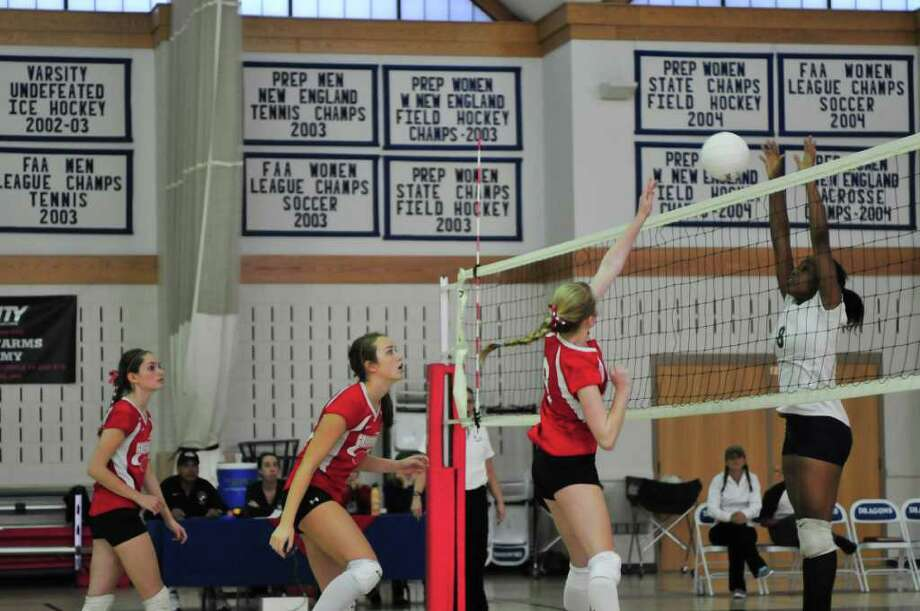 Greens Farms Academy's Sarah MacDonell (Westport), tips the ball at the New England tournament last Saturday. MacDonell led the Dragons to the finals with 30 assists, 18 kills and 12 blocks. Photo: Contributed Photo