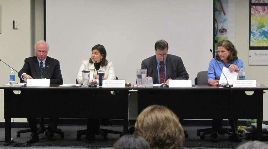 The Board of Education on Tuesday not only revised policies dealing with tobacco but also voted on the board chairman, vice-chairman and secretary positions. Pamela Iacono, seated second from left, was elected chairman. The gentleman to her right, Phil Dwyer, was elected vice-chairman. At far right is Jessica Gerber, who was elected secretary. Seated between Iacono and Gerber is Superintendent of Schools David Title. Photo: Kirk Lang