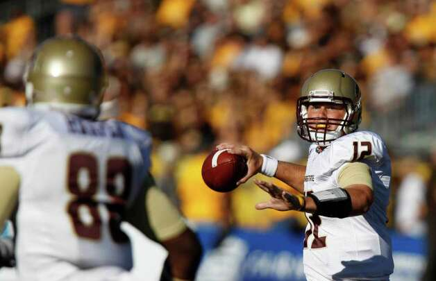 Texas State quarterback Tyler Arndt throws a pass to tight end Chase Harper (88) during a NCAA college football game against Wyoming, Saturday, Sept. 10, 2011, at War Memorial Stadium in Laramie, Wyo. Photo: AP