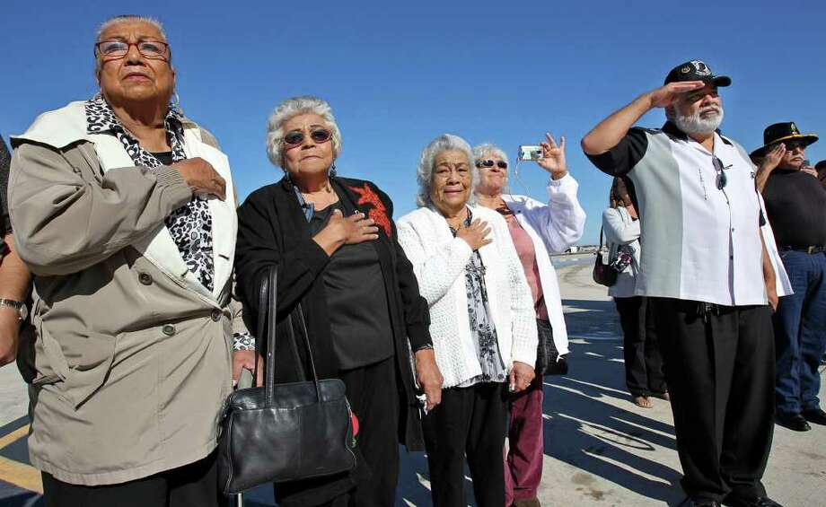 Siblings Eloise Gaitan Horne (from left), Angie Gaitan and Ruth G. Adams are joined by Manuel Adams (second from right) and John Edward Gaitan as the remains of their brother and uncle return to San Antonio. Photo: TOM REEL, SAN ANTONIO EXPRESS-NEWS / © 2011 San Antonio Express-News