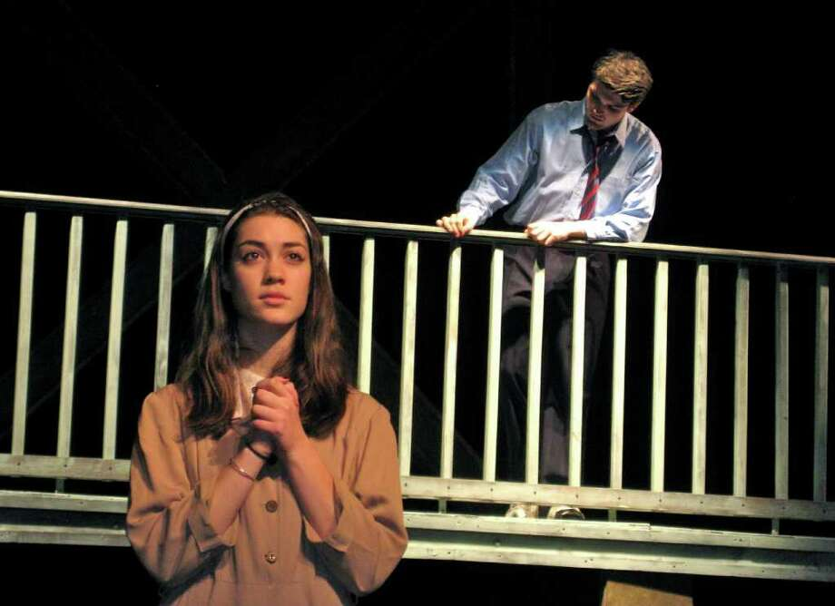 """Mary Bailey, played by Miriam Goldfield, prays for her husband, George (Steve Autore) as he stands on a bridge in Fairfield Ludlowe High School's production of """"It's a Wonderful Life,"""" playing Dec. 2 and 3 at the school. Photo: Contributed Photo / Fairfield Citizen contributed"""