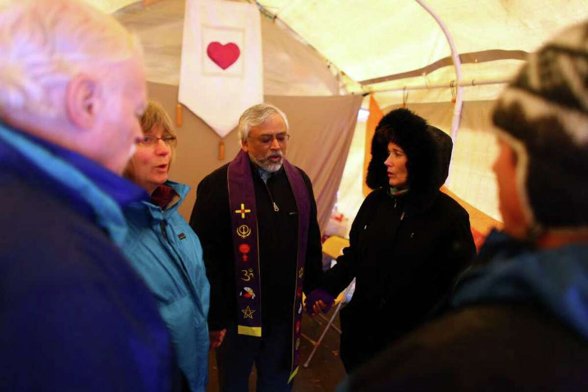 Muslim imam Jamal Rahman, center, leads a chant in the meditation tent at the Occupy Seattle encampment at Seattle Central Community College.