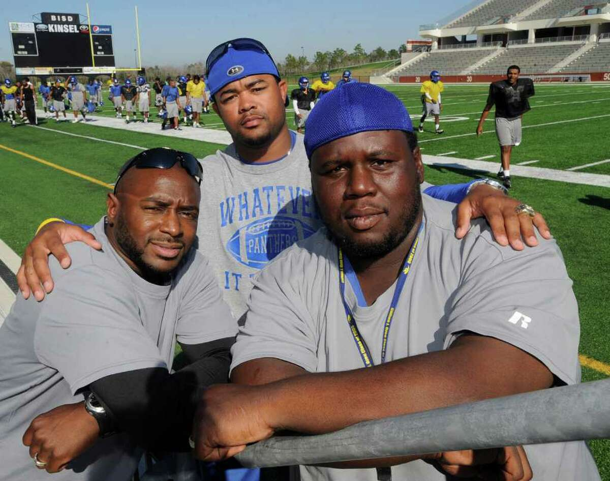 Ozen assistant coaches Freddy Strange, left, Caleb Ceaser and Edward Taylor, right, played on Ozen High School's first playoff team in 1998 and returned to the school to help the football team reach the playoffs again. Dave Ryan/The Enterprise