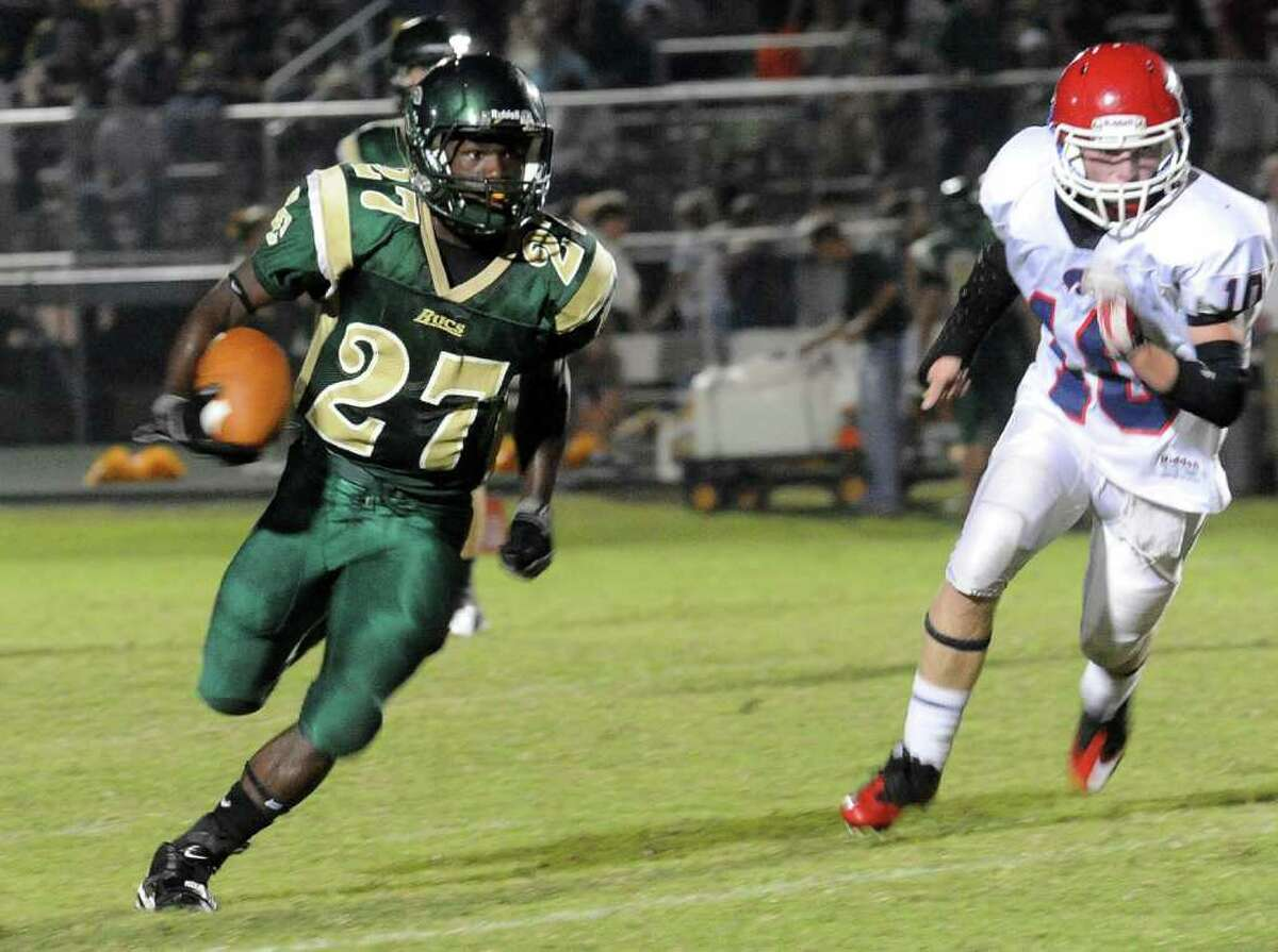 East Chambers' Glenn Roberts runs the ball during the game against Hardin Jefferson at East Chambers High School in Winnie, Friday, September 16, 2011. Tammy McKinley/The Enterprise