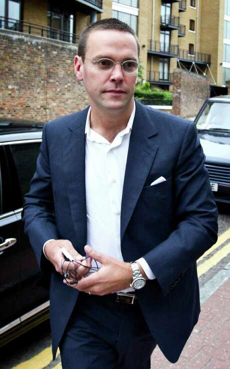 (FILES) A file picture taken on July 13, 2011, shows James Murdoch arriving for work in east London. James Murdoch has resigned as a director of several British newspapers including The Sun and The Times, documents and sources said Wednesday November 23, 2011, in the latest shake-up at his father Rupert's empire.  AFP PHOTO / Warren Allott (Photo credit should read Warren Allott/AFP/Getty Images) Photo: WARREN ALLOTT / AFP