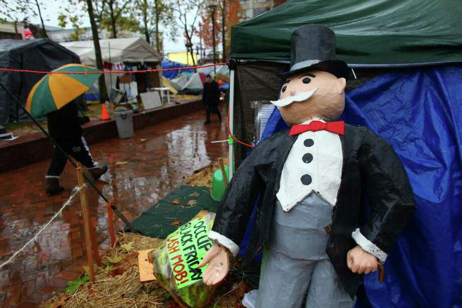 A statue of 'Mr. Monopoly' is shown at the Occupy Seattle encampment at Seattle Central Community College. Photo: JOSHUA TRUJILLO / SEATTLEPI.COM