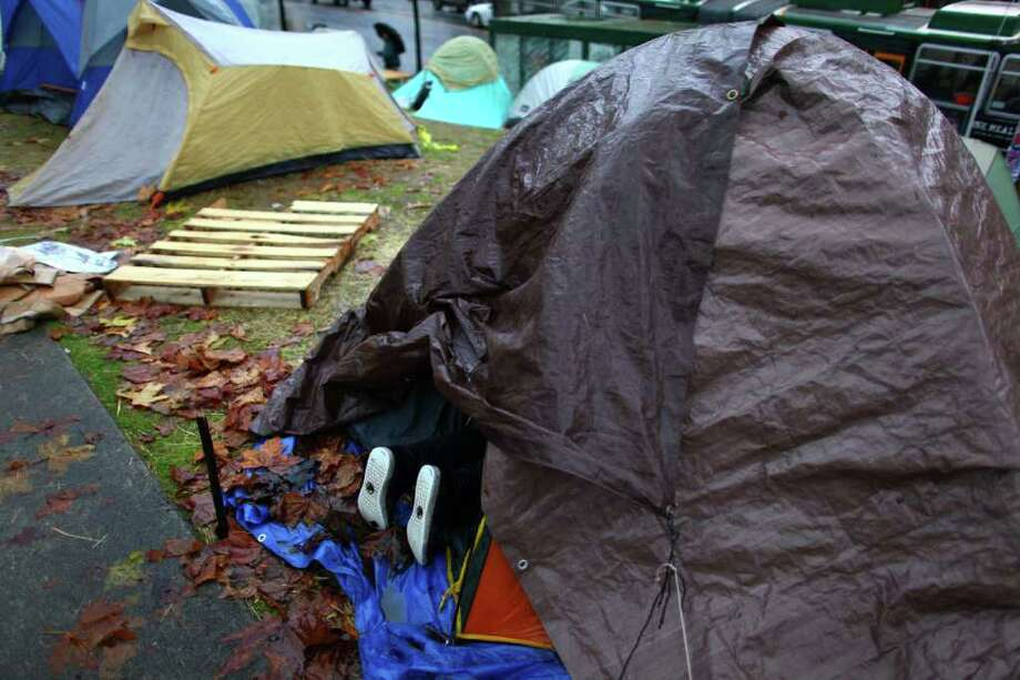 A camper organizes her belongings at the Occupy Seattle encampment at Seattle Central Community College. Photo: JOSHUA TRUJILLO / SEATTLEPI.COM