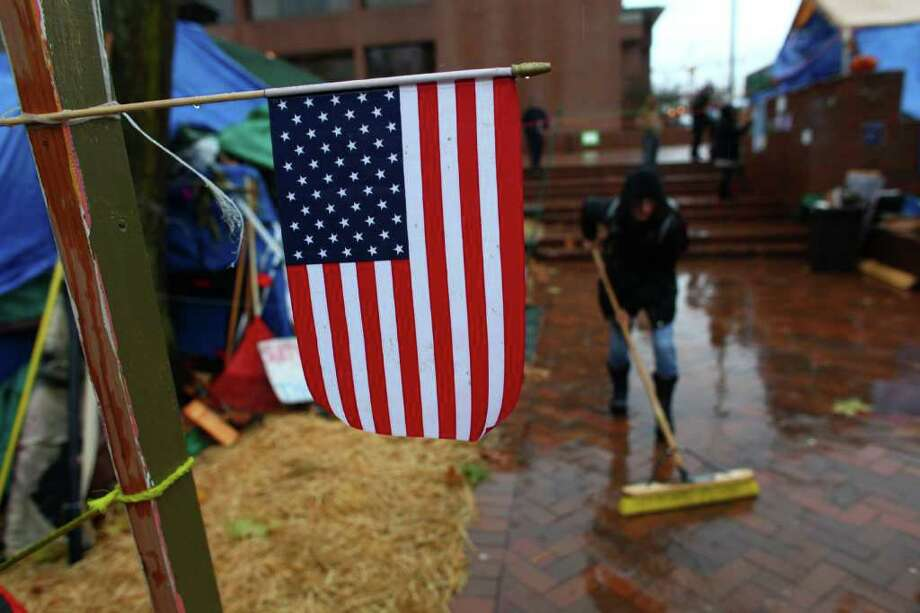 Residents work to clean up on Wednesday, November 23, 2010 at the Occupy Seattle encampment at Seattle Central Community College. Members of the camp were working to clean trash from the camp as a board of community college trustees were voting to evict Occupy Seattle from Seattle Central Community College campus. Photo: JOSHUA TRUJILLO / SEATTLEPI.COM