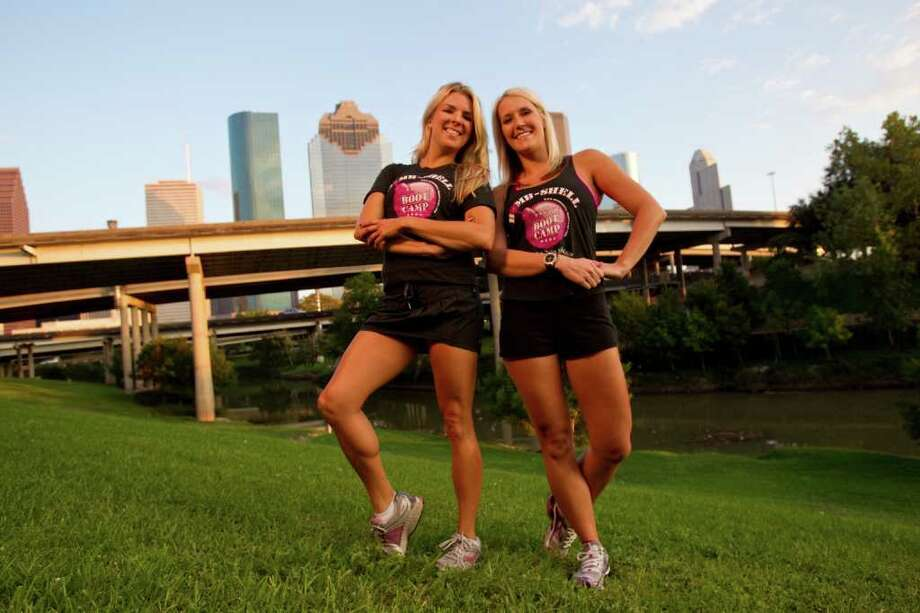 Cari Shoemate, left,  and Carrie Barnhart, right, pose together before  they lead their Bombshell Bootcamp classes on the banks of Buffalo Bayou Tuesday, Oct. 25, 2011, in Houston. ( Melissa Phillip / Houston Chronicle ) Photo: Melissa Phillip / © 2011 Houston Chronicle