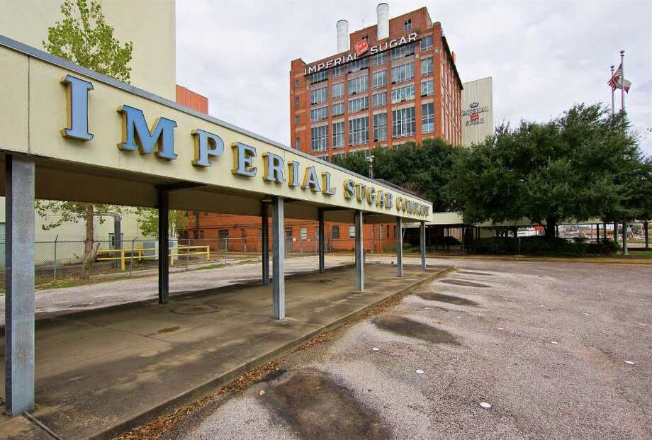 The Imperial Sugar Co. in Sugar Land sits empty since its closing in 2003. Land development is planned for this historic site. The char house, in the background, will be salvaged and remain on site. Photo: Frank Casimiro / Freelance