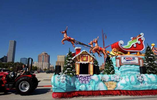 Courtney Padgett drives a Thanksgiving float made by the float design firm Studio 3 to Minute Maid Park Wednesday, Nov. 23, 2011, in Houston. Photo: Cody Duty, Houston Chronicle / © 2011 Houston Chronicle