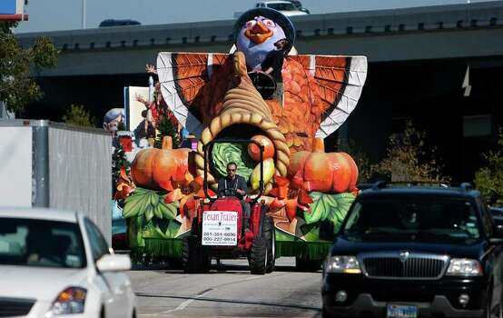 Jonathan Bertuccelli, owner of the float design firm Studio 3, drives a Thanksgiving float to Minute Maid Park. Photo: Cody Duty, Houston Chronicle / © 2011 Houston Chronicle