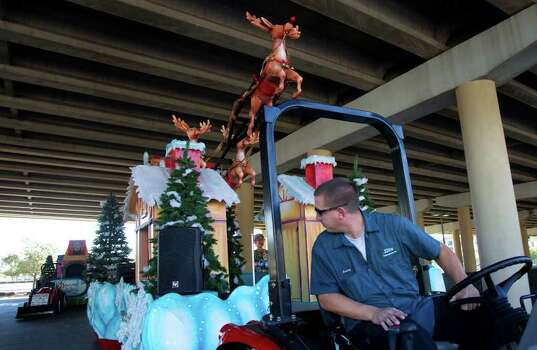 Courtney Padgett backs a Thanksgiving float made by the float design firm Studio 3 under the overpass in a parking lot next to Minute Maid Park. Photo: Cody Duty, Houston Chronicle / © 2011 Houston Chronicle