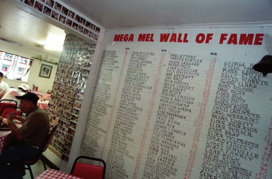 CONTACT FILED:  MEL'S COUNTRY CAFE At Mel's Country Cafe, the Mega Mel Wall of Fame lists the brave hearts and big appetites who finished the famous Mega Burger, a 1.5-pound burger with bacon.  Each honoree's time to complete the ingestion of the mammoth burger is listed beside their name. Photo: John Everett / Houston Chronicle