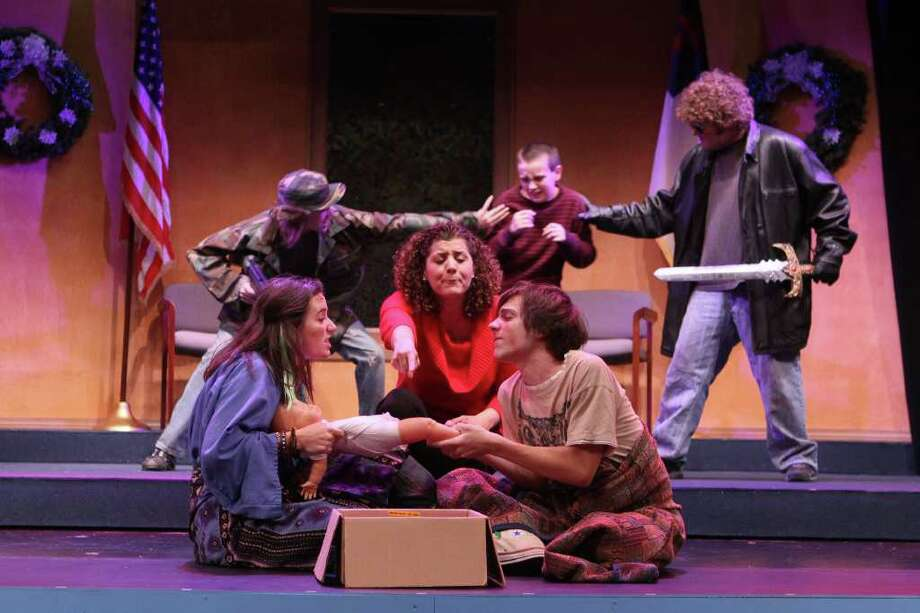 """Actors ( L to R front) Kristin Rice 18, Katharine Hatcher (cq), Thomas Miller 17, (L to R back) Daniel Miller, Joseph Parker 11,  Garrett Wilson in a scene from the A.D. Players production of """"The Greatest Christmas Pageant Ever"""" in Houston on November 16, 2011. (Alan Warren, For the Chronicle) Photo: Alan Warren / ©2011 Houston Chronicle"""