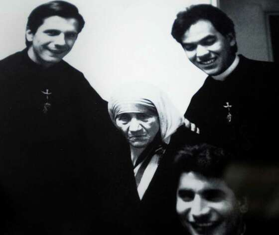 Gustavo Garcia-Siller as s a young priest, left, posed for a picture with Mother Teresa of Calcutta in the mid 1990s. HO Photo: HO, SAN ANTONIO EXPRESS-NEWS / gcalzada@express-news.net