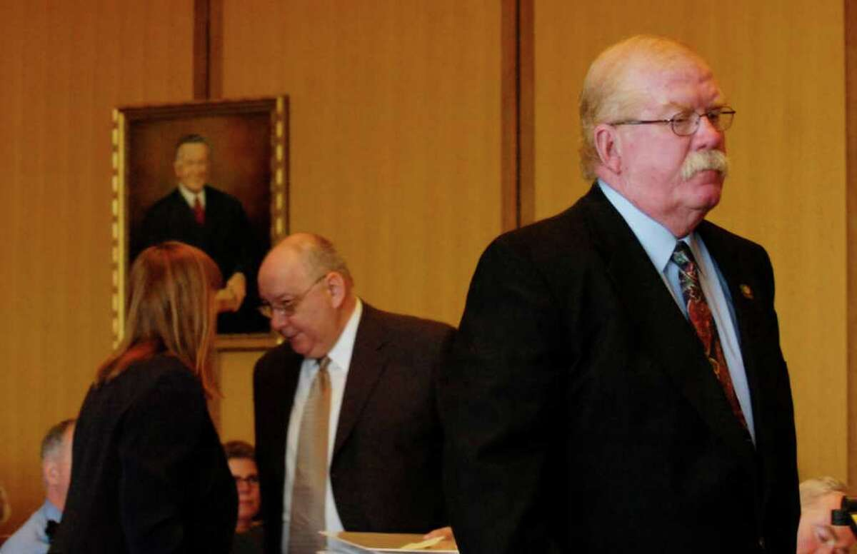 Former Greenwich police detective James Lunney walks to the witness stand in state Superior Court in Stamford during a 2007 hearing on the Martha Moxley murder. Lunney testified about the investigation into the 1975 killing of the Greenwich teen. (FILE PHOTO)